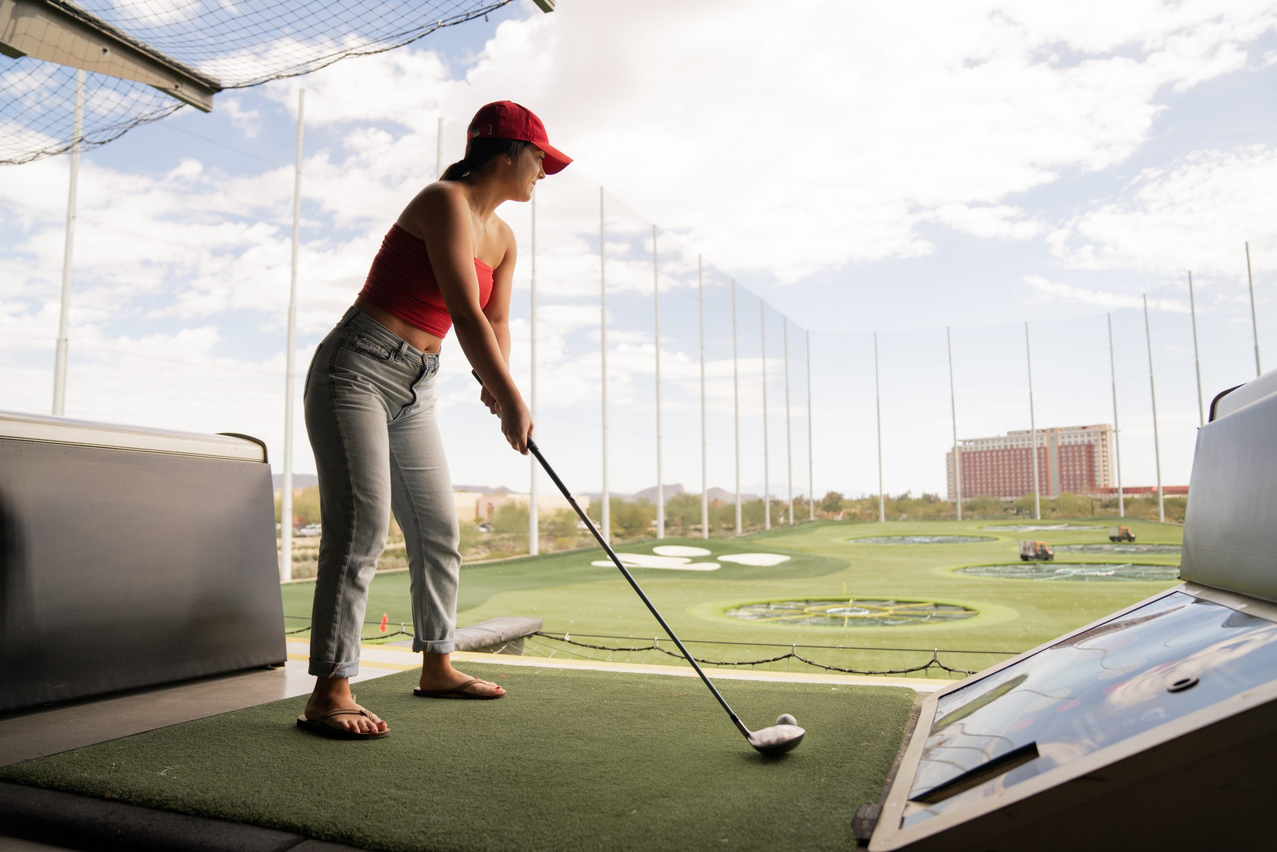 woman working on her golf swing sequence